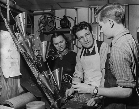 "Elizabeth, Hans and Norman in Hans' home basement shop in Evanston Illinois about 1950, after Hans left Cellini Craft, and a couple years before their big move out to the ""wilds"" of California, as it was then popularly understood to be."